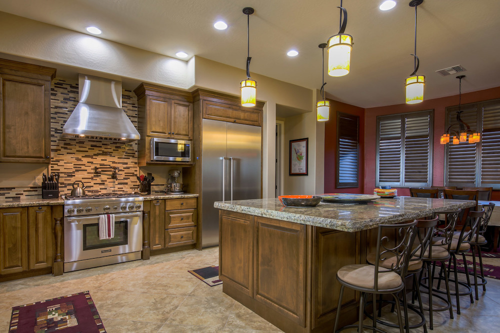 Tempe, Arizona kitchen remodel by Maverick Kitchens using Medallion cabinetry with Rushmore doors, maple wood, Amaretto stain, and ebony glaze